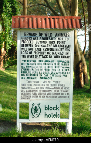 Sign warning of the danger of wild animals in the grounds of Lake Naivasha Club Kenya East Africa - Stock Photo