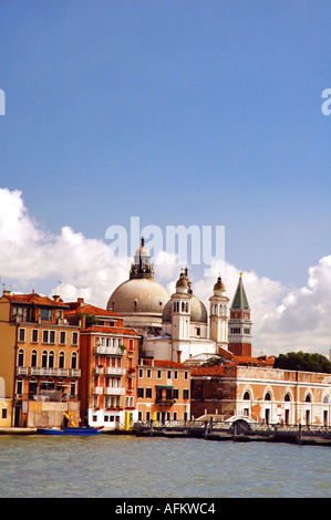 Santa Maria della Salute in the midst of Venice. Blue sky and water shown. - Stock Photo