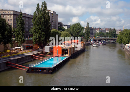The Badeschiff or Bathing Ship a swimming pool built into a barge floating on the Danube Canal, Vienna, Austria - Stock Photo