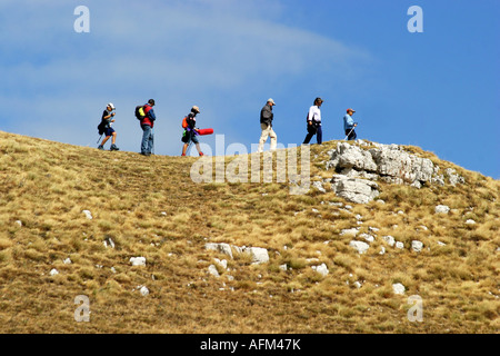 Hikers enjoy the Glorious colour of Sasso Tetto  mountain in the Sibillini National Park,Le Marche,the Marches, - Stock Photo