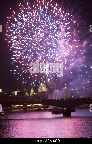 Lord Mayors Show fireworks on River Thames with City of London and St Pauls Cathedral in background - Stock Photo