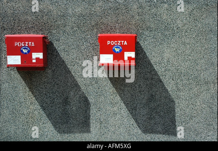 Two red letter postal box s, one old and one new on a gray wall, Warsaw, Poland, Europe, EU - Stock Photo
