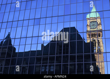 '19th century' 'civic building' reflected in '20th century' 'office building' Toronto Ontario Canada - Stock Photo