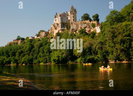 Cingle de Monfort and CanoeistsPaddling Down the Dordogne River in France - Stock Photo