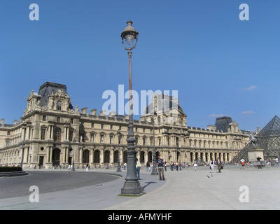 Napoleon courtyard seen from Place du Carrousel square in front of Louvre Paris France - Stock Photo