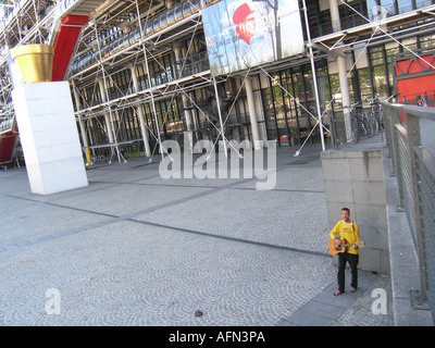 Single street musician at empty square in front of Centre Pompidou Paris France - Stock Photo