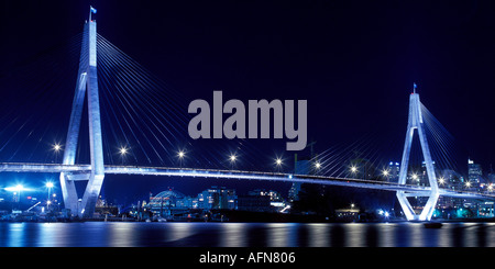 Anzac Bridge or Glebe Island bridge spanning Johnstons Bay is one of Sydney by night - Stock Photo