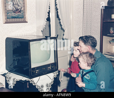 Stock Photo 1950s Family With 3 Children Watching Tv 12666412 on old fashioned families gathered around radio