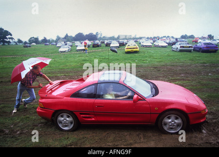 A SPORTS CAR STUCK IN THE MUD AT A TOYOTA MR2 GALA IN TETBURY GLOUCESTERSHIRE UK - Stock Photo