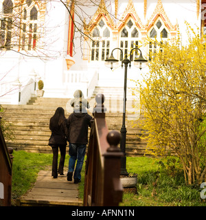 Wat Buddhapadipa Thai Buddhist temple in Wimbledon London No model release required as back shots of people so unrecognizable - Stock Photo
