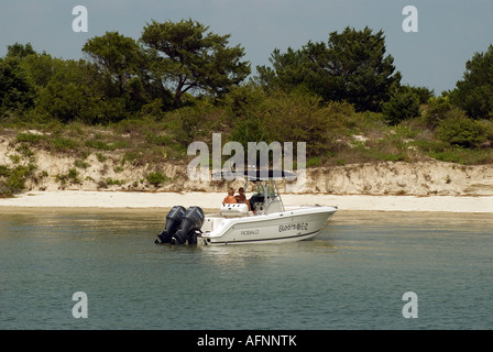 boating couple takes a break along Salt Run in Matanzas Bay St Augustine Florida - Stock Photo