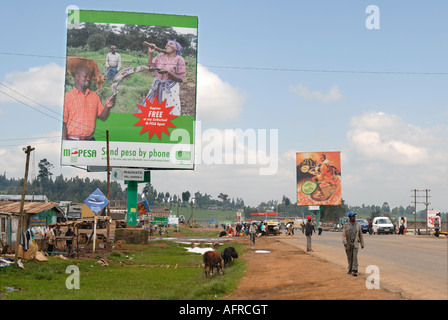 A huge advertising hoarding for Safaricom at the side of the main road at Mau Summit Kenya East Africa - Stock Photo