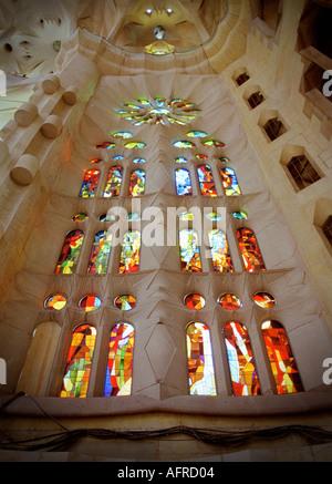 Painted glass inside Gaudi s famous cathedral La Sagrada Familia in Barcelona Spain - Stock Photo