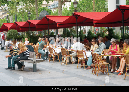 People sitting at traditional French café, on the pavement , during summer day, Champs De Elysees Avenue, Paris, - Stock Photo