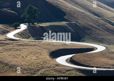 Highway curves leading upward. - Stock Photo