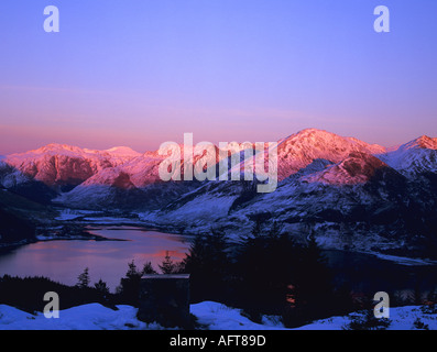 RATAGAN SCOTTISH HIGHLANDS UK February Snow covered mountains around Loch Duich in late evening light - Stock Photo