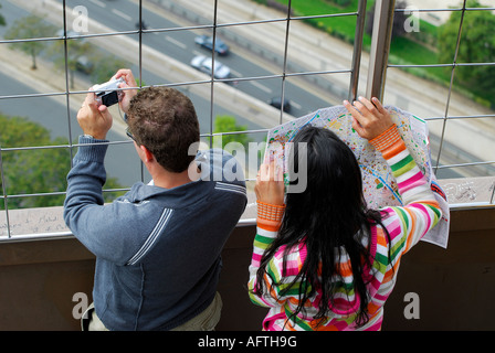 tourists on eiffel tower, paris, france - Stock Photo