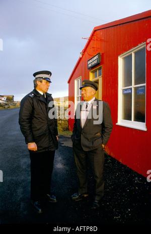 Local policeman and postmaster Haroldswick Post Office Isle of Uist Shetland islands Scotland 1995 - Stock Photo