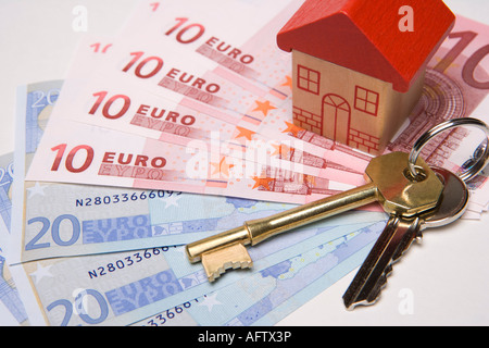Keys to new house Buying or investing in property or house overseas or abroad with euros - Stock Photo