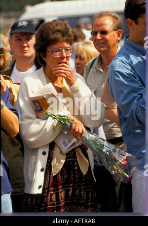 Diana Princess of Wales public leave flowers as a floral tribute memorial September 1997 Buckingham Palace London - Stock Photo