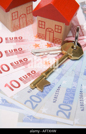 Keys to new houses Buying or investing in property or housing overseas or abroad with euros - Stock Photo
