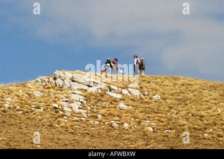 hikers enjoy Glorious colour at Sasso Tetto  mountain in the Sibillini National Park,Le Marche Italy - Stock Photo