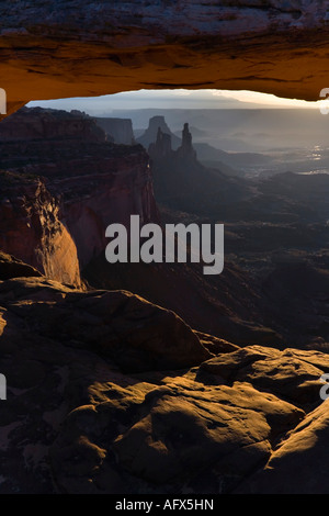Sunrise on Mesa Arch in the Canyonlands National Park of Utah USA - Stock Photo