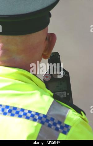 PSNI (Police Service of Northern Ireland) traffic branch officer using speed gun - Stock Photo