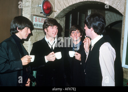 THE BEATLES backstage at a UK theatre in 1964 - Stock Photo