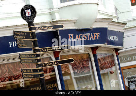 shop and signpost in cowes high street giving visitors and tourists information - Stock Photo