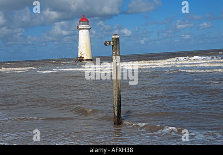 TALACRE WARREN FLINTSHIRE NORTH WALES UK August Walkers signpost in front of Talacre Lighthouse with tide coming - Stock Photo
