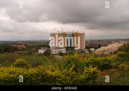 INDIA Hyderabad Andhra Pradesh Clouds over modern building in Hi tech city - Stock Photo