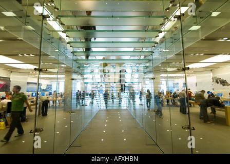 Interior of the Apple store in Regent Street London - Stock Photo
