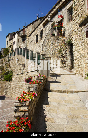 Provence, France - Narrow cobbled ally and traditional houses in the village of Bairols, Alpes Maritimes - Stock Photo