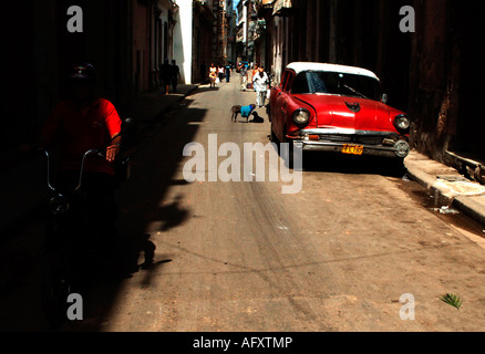 Cuba Havana Habana Vieja a vintage oldtimer car in one of the alleyways - Stock Photo