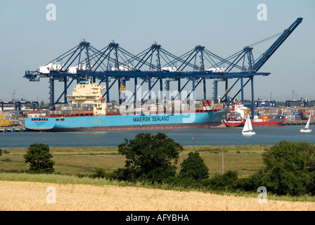 Felixstowe Container Port and the River Orwell with ship Maersk Sealand - Stock Photo