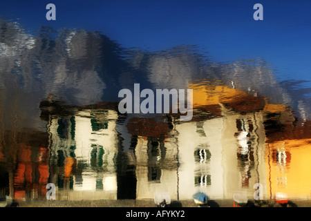 Pescarenico old house reflected in the river, Lecco Italy - Stock Photo