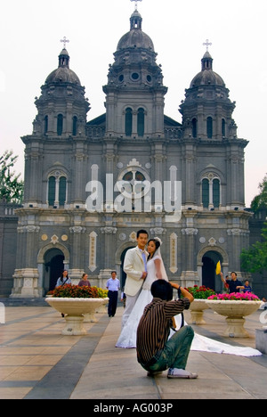 'Beijing CHINA', Young Chinese Newly Weds Couple Posing for Photographer in Front of 'Catholic Church' Sanctuary - Stock Photo