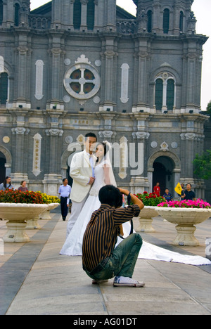 Beijing CHINA, 'Young Chinese Newly Weds' Couple Posing for Photographer in Front of Catholic Church Sanctuary - Stock Photo