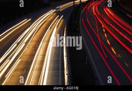 CAR LIGHTS TRAILS ON ROAD AT NIGHT. FRANKFURT AM MAIN , GERMANY. - Stock Photo