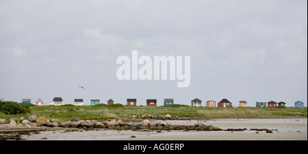 Beach House Panorama A long row of tiny colourful beach houses typically Danish top the thin strip of land that - Stock Photo