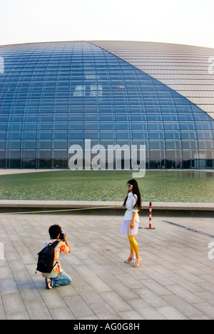 'Beijing CHina', Photographer Shooting Female Model In Front of the 'National Grand Theatre' - Stock Photo