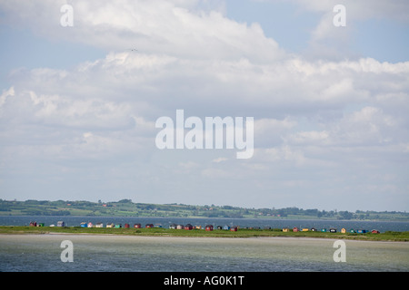 Beach Houses from Above A long row of tiny colourful beach houses typically Danish line the thin strip of land that - Stock Photo
