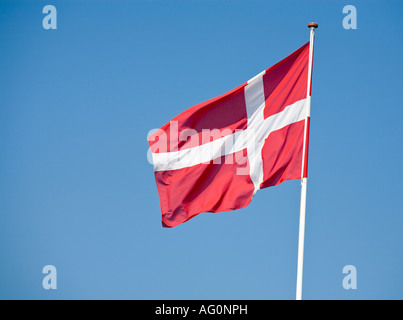 Danish Flag Blue Sky A Danish flag flying in a breeze in the sunshine and against a blue sky Funen Fyn Denmark - Stock Photo