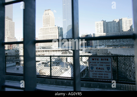 looking through the metal fence down onto the world trade center reconstruction site ground zero new york city new - Stock Photo