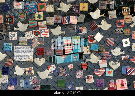 9 11 tile memorial tiles made by american children and displayed on fence on 7th avenue new york city new york USA - Stock Photo