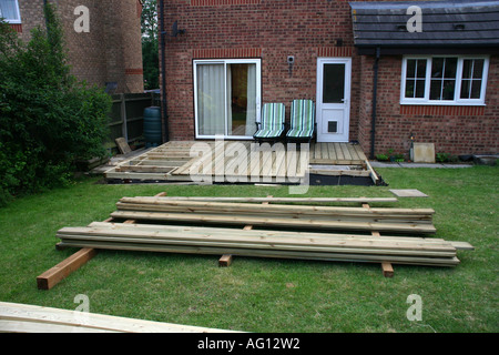 Deck Under Construction in Back Garden - Stock Photo