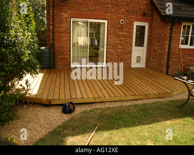 Newly Constructed Deck in Back Garden - Stock Photo