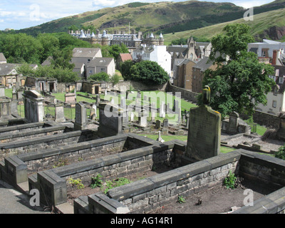 View towards the Palace of Holyrood House from New Calton Hill Burial Ground, Edinburgh, Scotland, UK. - Stock Photo