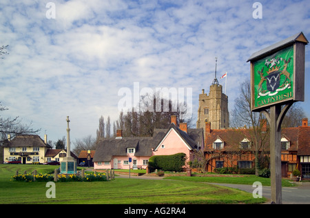 Cavendish Suffolk in Spring with sign and daffodils April 2005 - Stock Photo